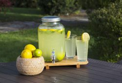 Lemonade prepared with lemon slices in a glass dispenser